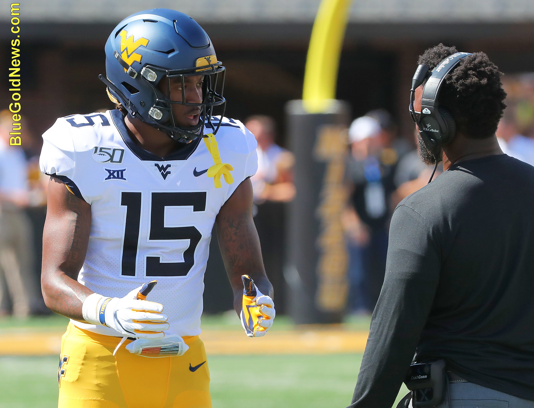 West Virginia safety Kerry Martin (15) gets instruction from WVU defensive assistant Al Pogue