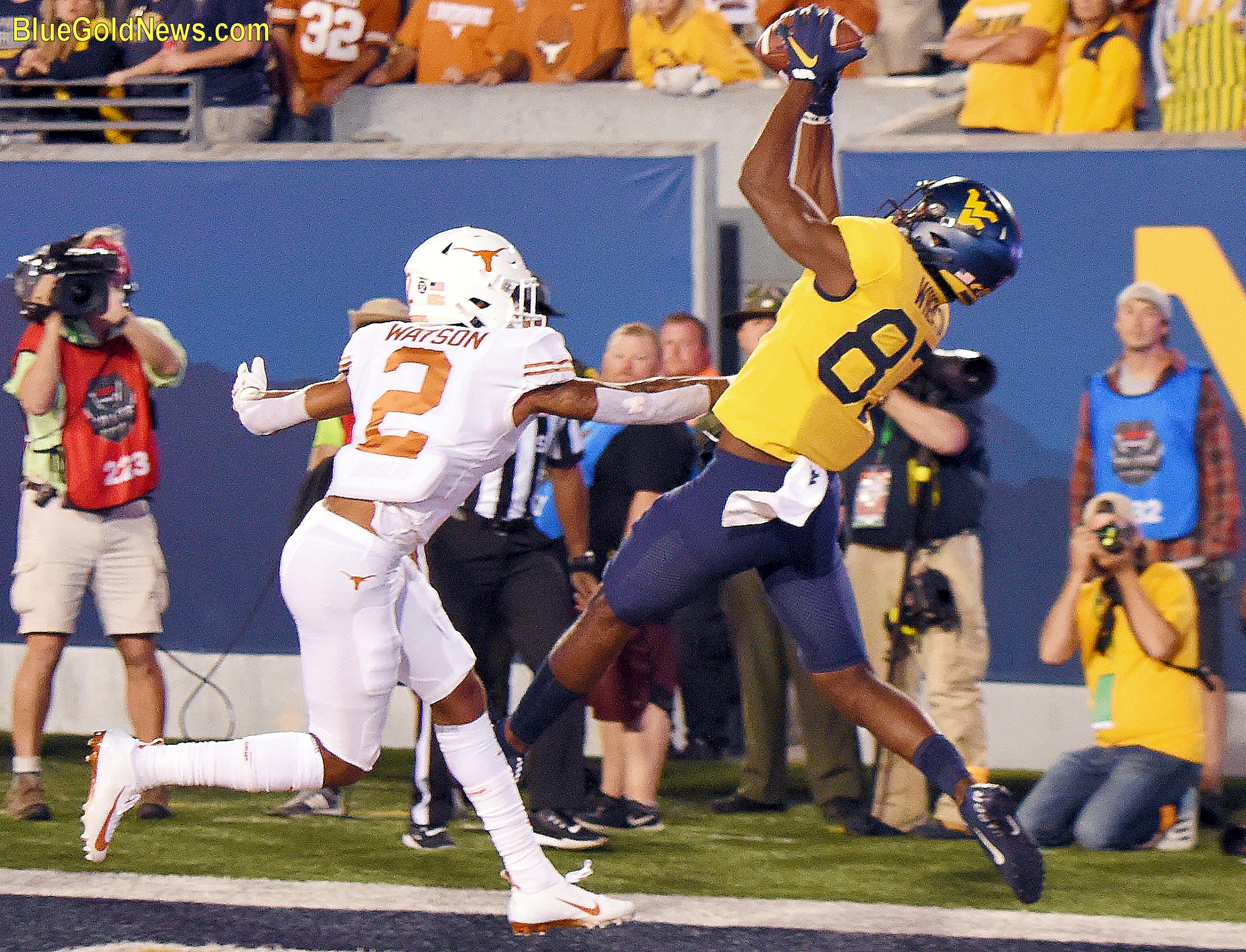 West Virginia receiver Bryce Wheaton hauls in a touchdown pass