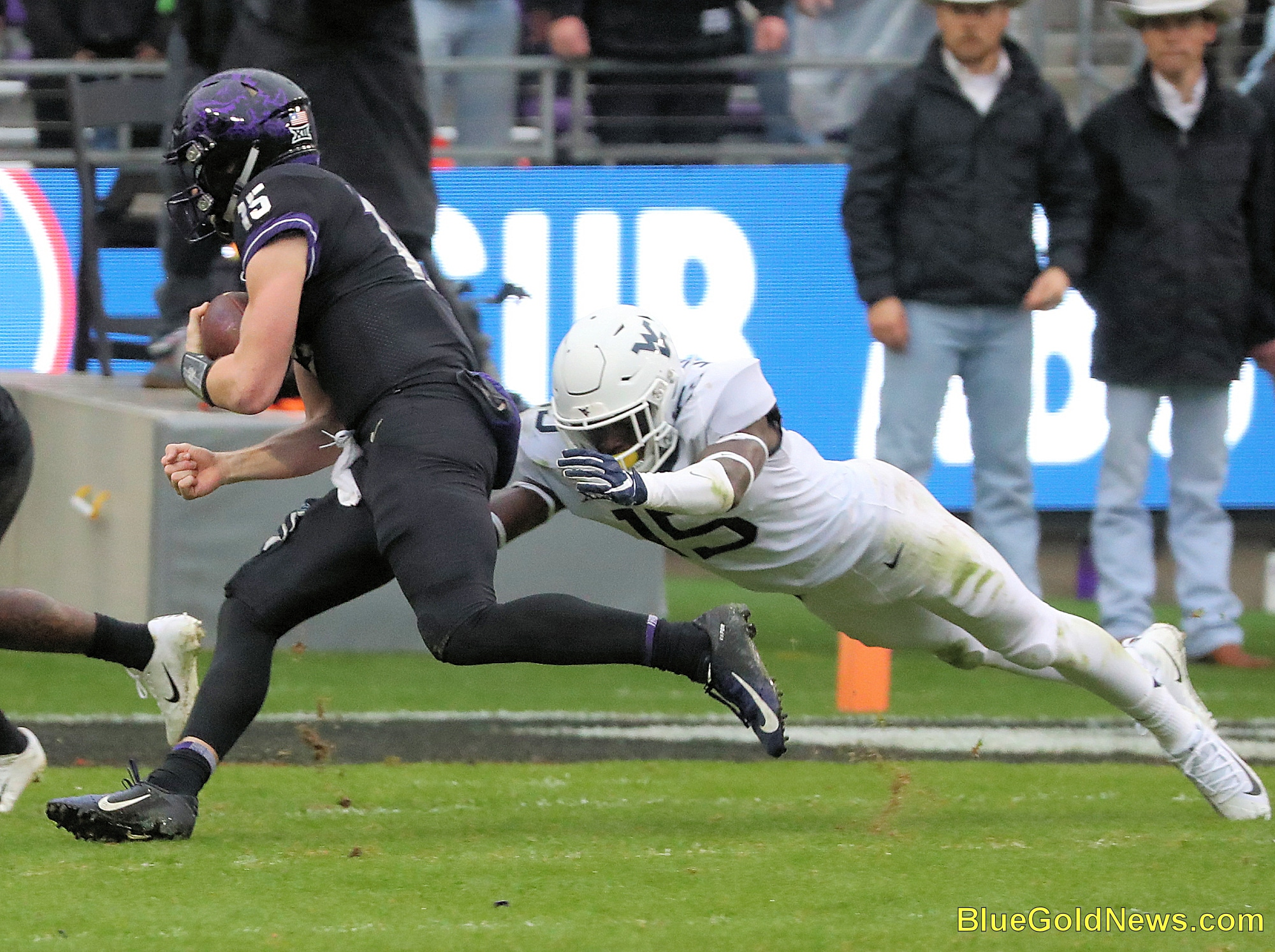 West Virginia safety Kerry Martin makes a diving tackle of TCU's Max Duggan (15)