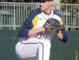 West Virginia pitcher Jackson Wolf winds to deliver a pitch