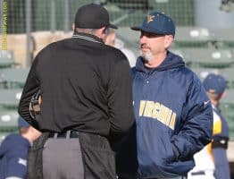 West Virginia head coach Randy Mazey (right) hears an explanation on a ground rule double from home plate umpire Matthew Cerimele