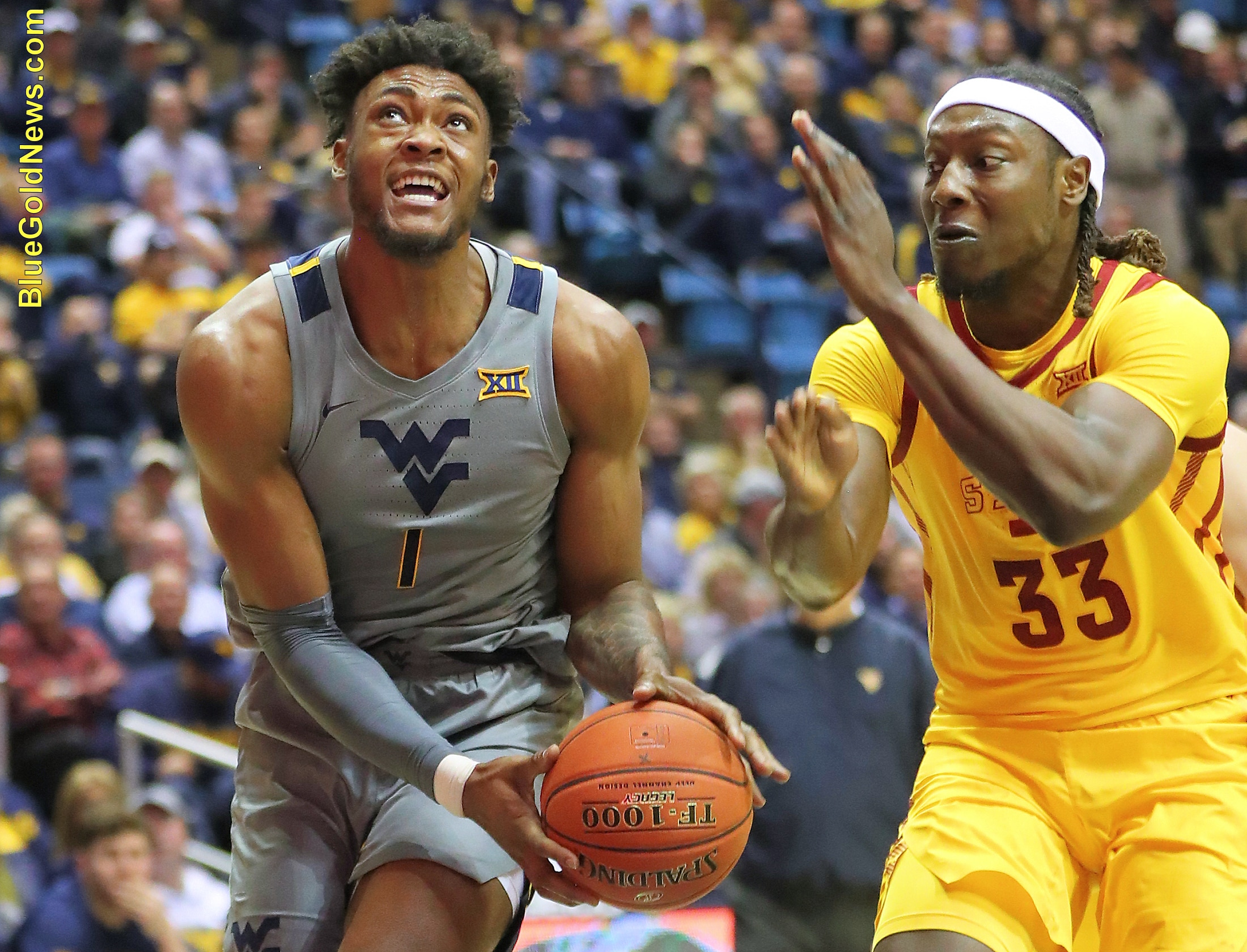 West Virginia forward Derek Culver (1) finds a lane past Iowa State's Solomon Young (33)