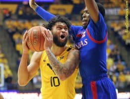 West Virginia forward Jermaine Haley (10) finds little room to operate against the Kansas defense