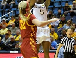 West Virginia guard Tynice Martin (5) elevates for a jumper over Iowa State's Maggie Espenmiller-McGraw (32)