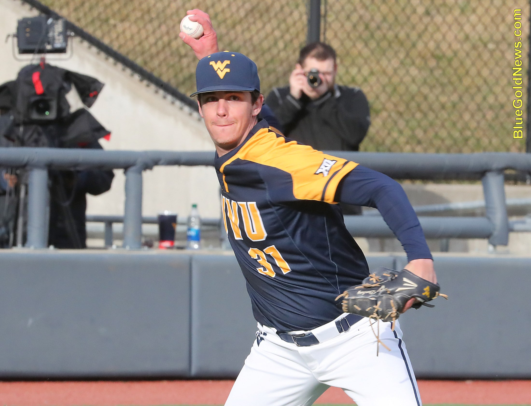 West Virginia pitcher Tyler Strechay fires to first after fielding a bunt