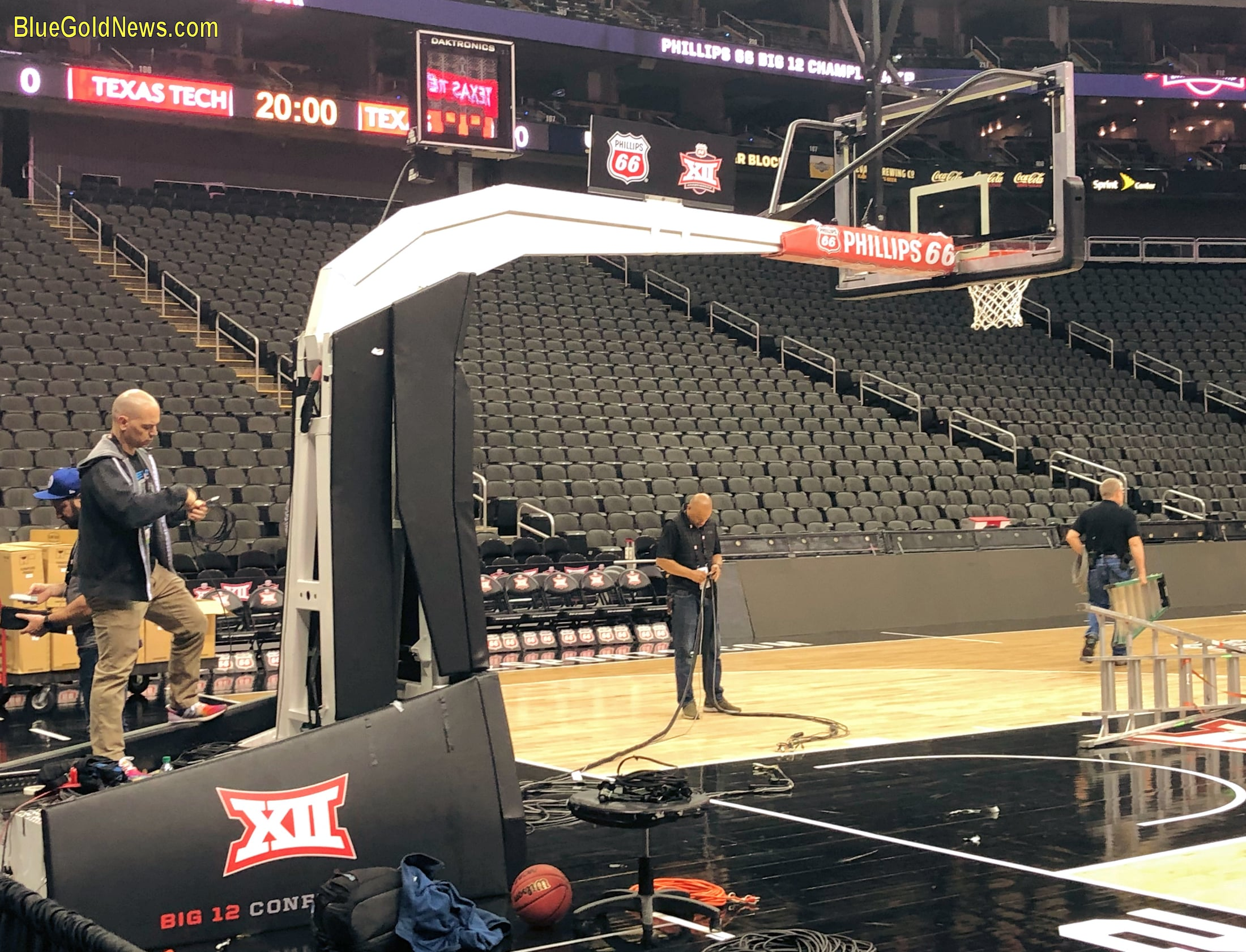 Workers begin the teardown process after the cancellation of the Big 12 Men's Basketball Championship