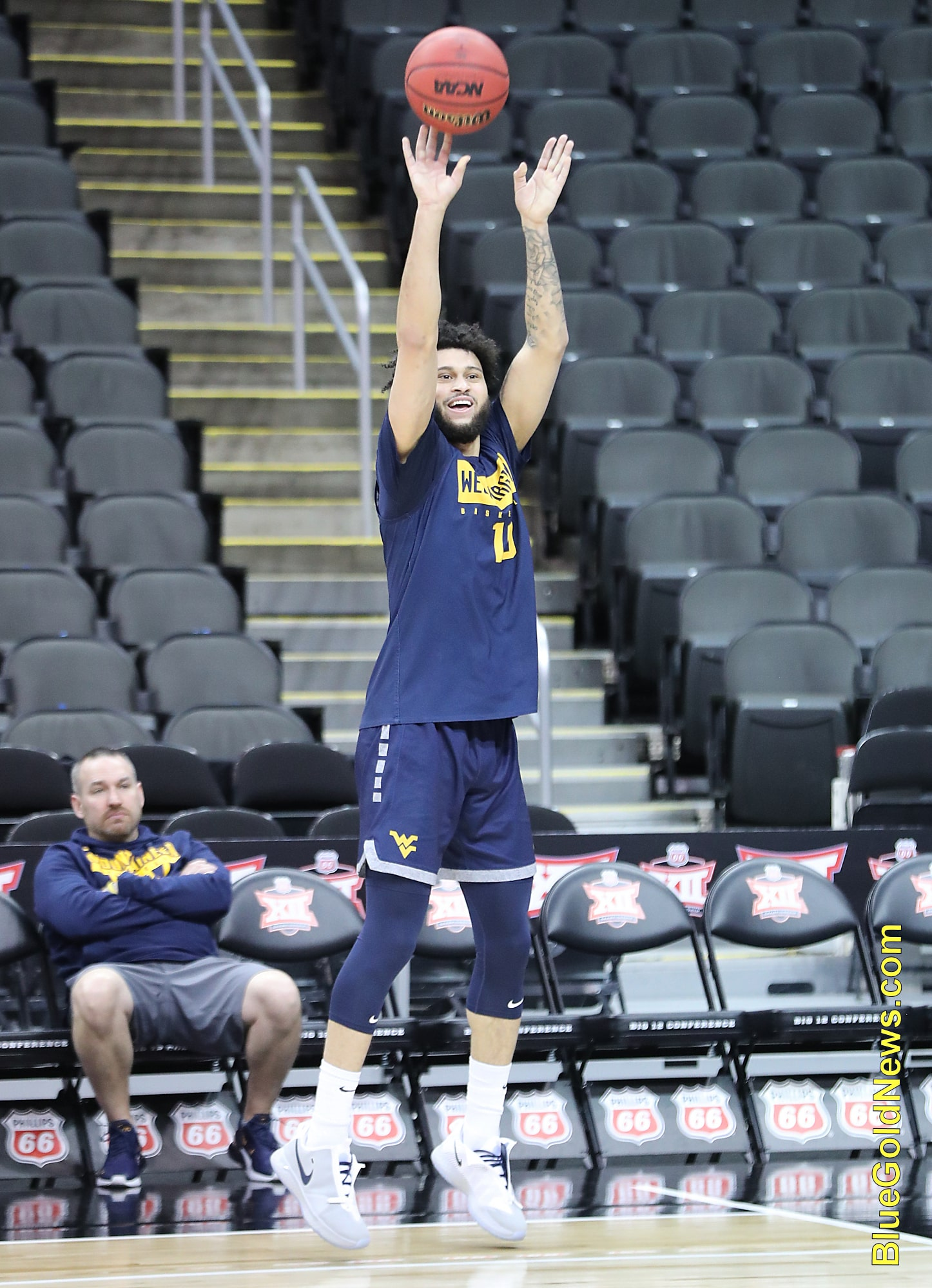 West Virginia guard Jermaine Haley has fun as he launches a shot from the corner