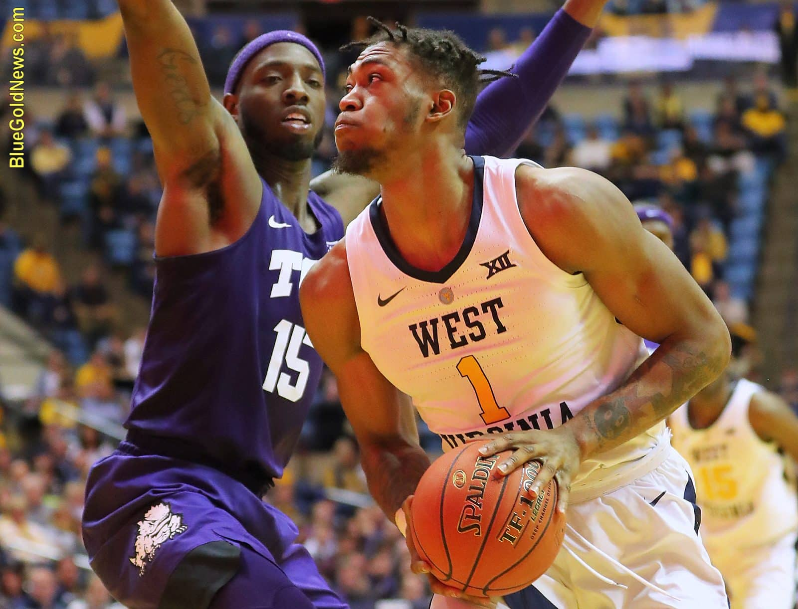 West Virginia forward Derek Culver (1) makes a move against TCU's JD Miller (15)