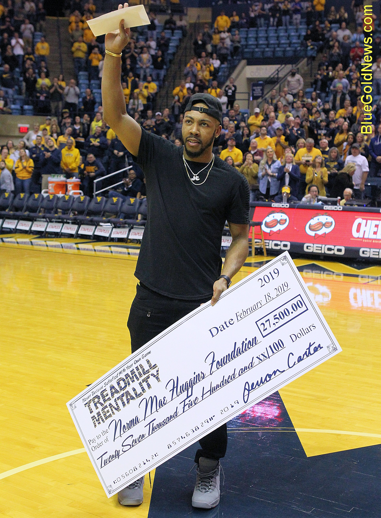 West Virginia alumnus Jevon Carter presents a check to the Norma Mae  Huggins Cancer Foundation 71a90987b