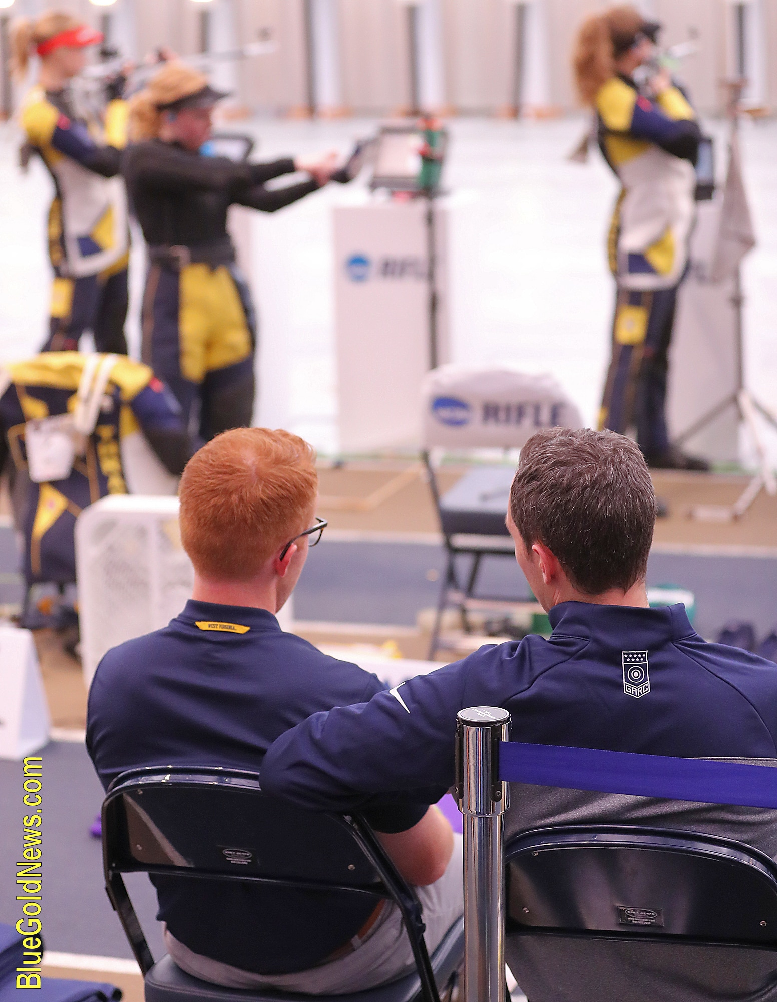 West Virginia graduate assistant Soren Butler (l) and head coach Jon Hammond watch a smallbore relay