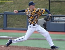 West Virginia pitcher Brock Helverson delivers to the plate