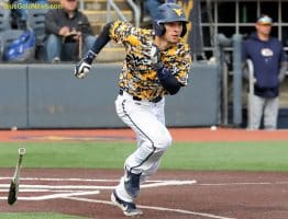 West Virginia right field Darius Hill hustles out of the box
