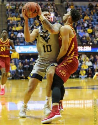 West Virginia guard Jermaine Haley (1) is fouled on a drive