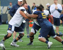 WVU's Behrndt Up For Challenge At Center, Even As Voice Suffers