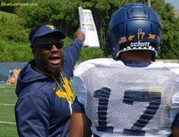 West Virginia assistant coach Al Pogue makes a point to the linebacker group, including Exree Loe (17)