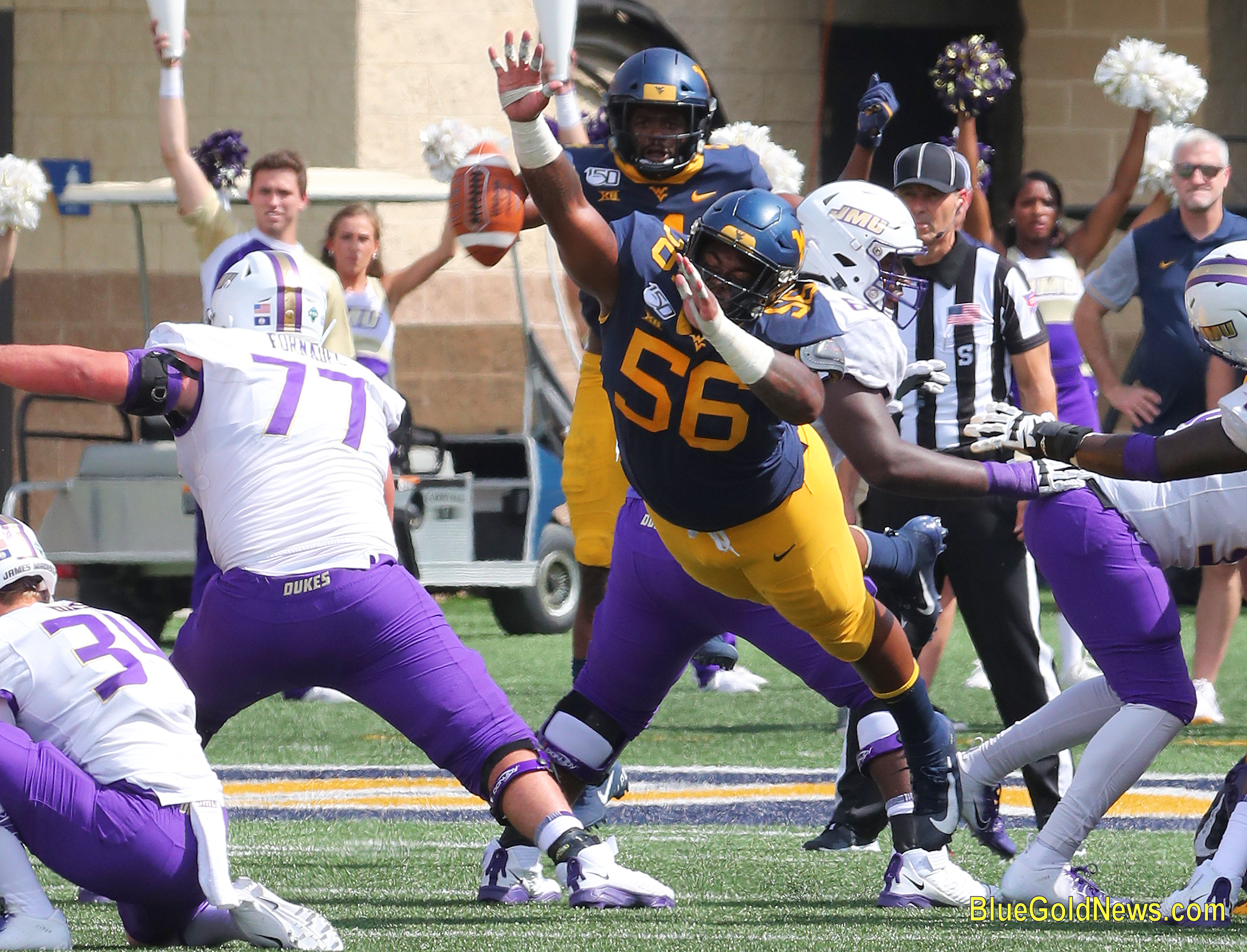 West Virginia defensive lineman Darius Stills (56) lays out to block a James Madison field goal