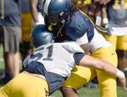 West Virginia linebacker Jake Abbott (51) delivers a solid hit during competition drill