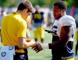 West Virginia linebacker Josh Chandler gets a re-wrap during practice