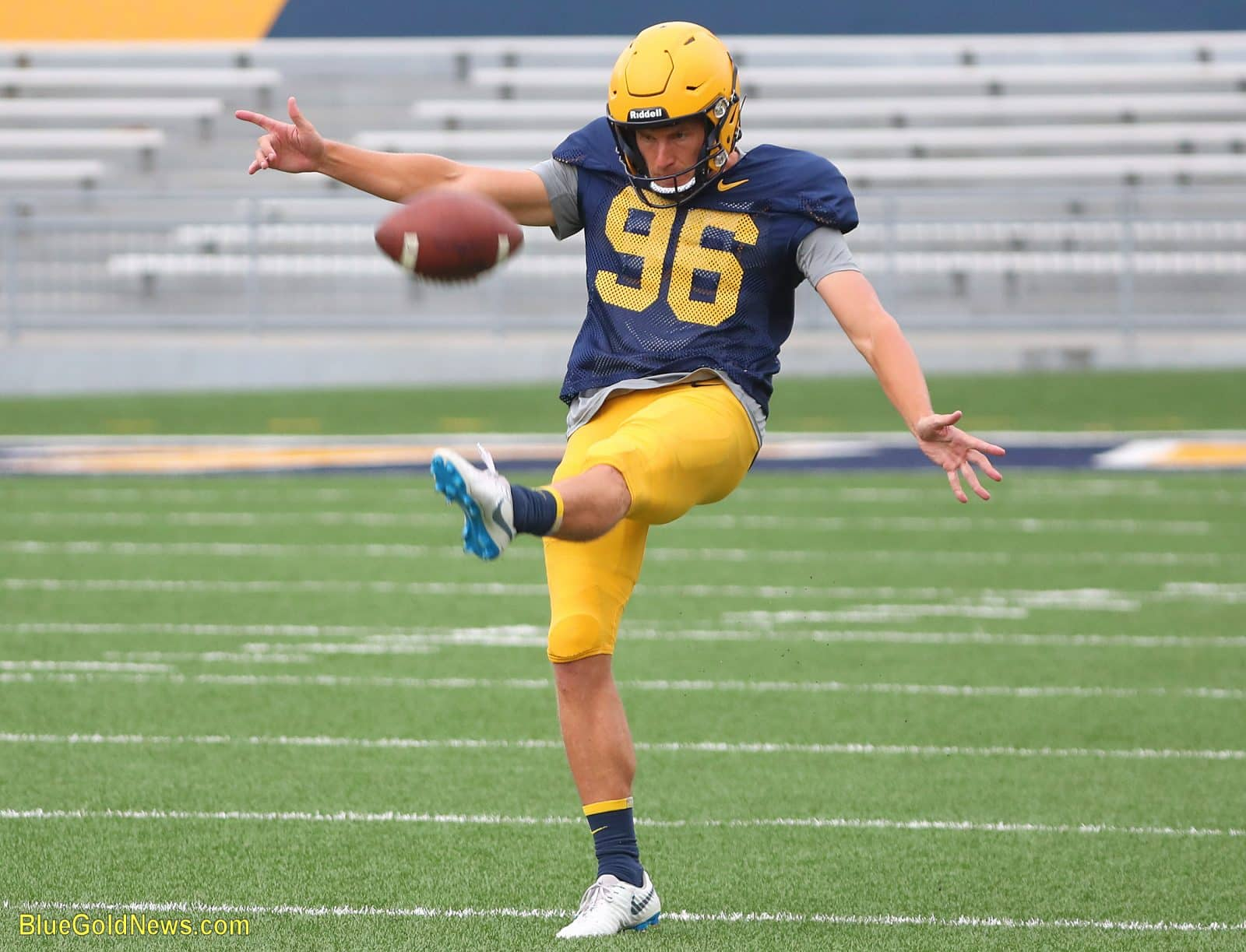West Virginia punter Josh Growden sends a kick on its way