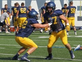 West Virginia fullback Logan Thimons (42) works on blocking from the punt shield against Joe Turner (47)