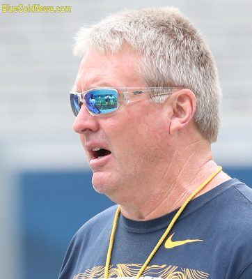 West Virginia defensive coordinator Vic Koenning directs his players through a drill