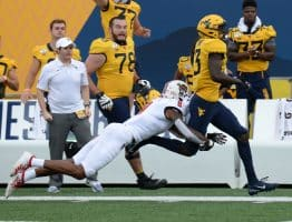 The West Virginia sideline gets hyped up for a kickoff