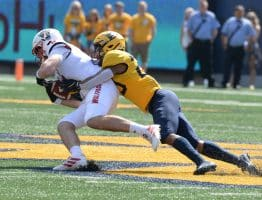 West Virginia safety Sean Mahone hauls down an N.C. State receiver