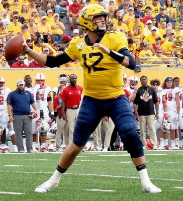 West Virginia quarterback Austin Kendall delivers a pass to the flat