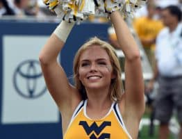 A West Virginia cheerleader celebrates a Mountaineer score