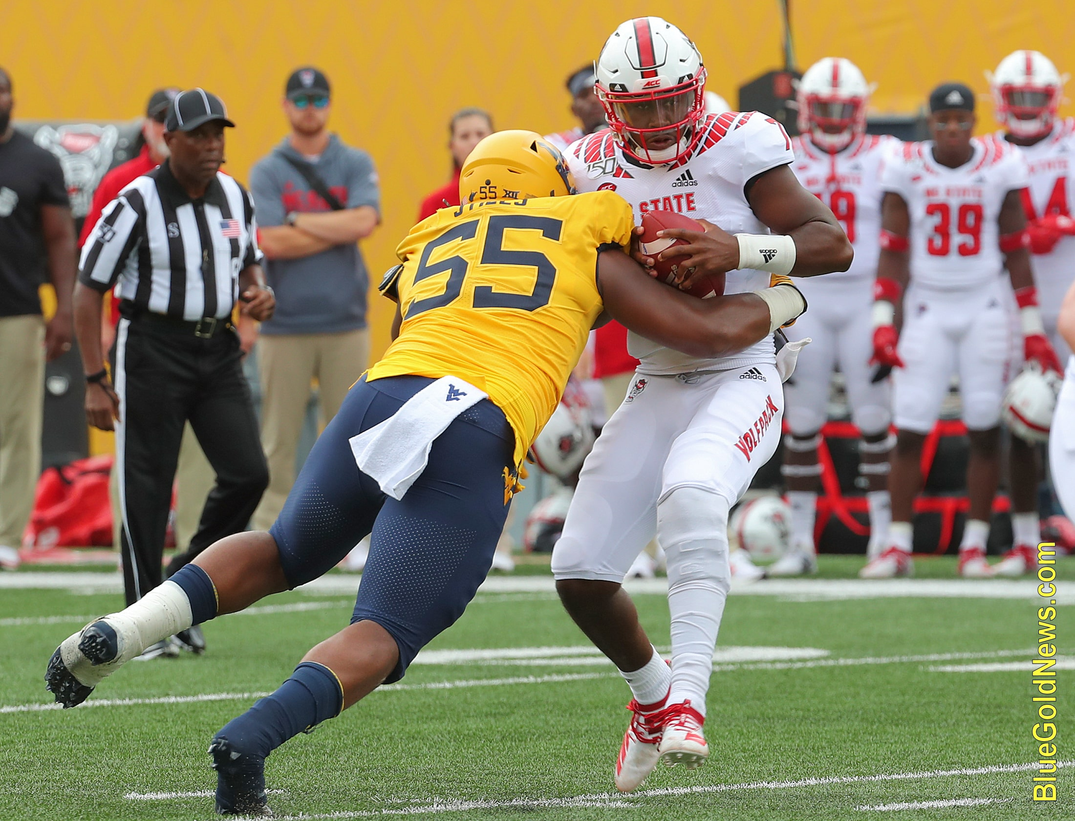 West Virginia defensive lineman Dante Stills (55) sacks NC State's Matthew McKay
