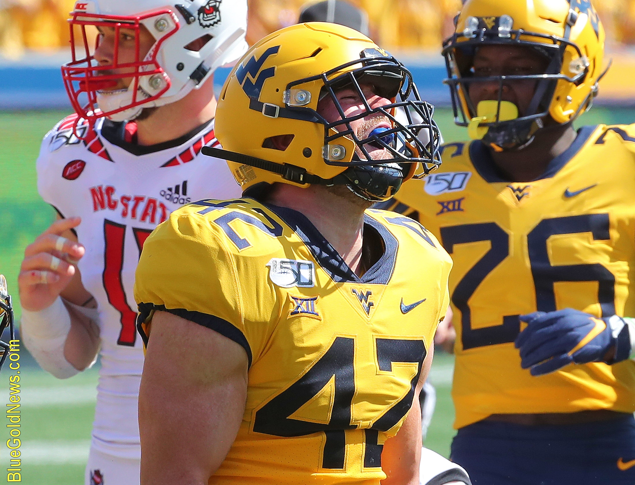 West Virginia fullback Logan Thimons celebrates his blocked punt against N.C. State