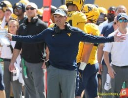 West Virginia head coach Neal Brown expresses disbelief at a targeting call