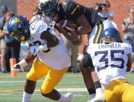 West Virginia safety Tykee Smith and linebacker Josh Chandler team up for a tackle on Missouri's Kelly Bryant