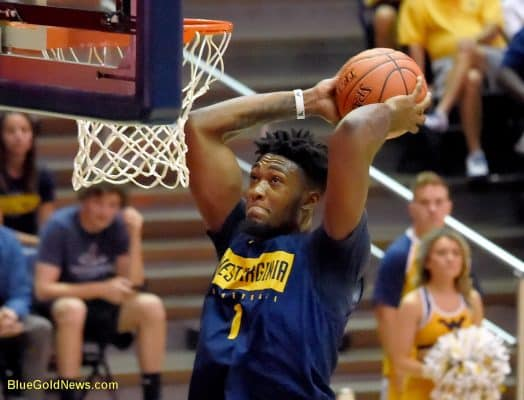 West Virginia forward Derek Culver rises for a dunk