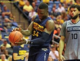 West Virginia forward Oscar Tshiebwe (34) shows frustration after missing a chance at a 3-point play