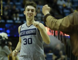 West Virginia walk-on guard Spencer Macke takes his first trip down the carpet