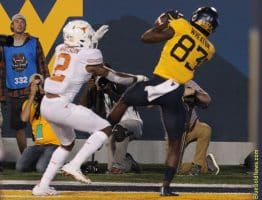 West Virginia receiver Bryce Wheaton (83) gets a foot down in the end zone for a touchdown