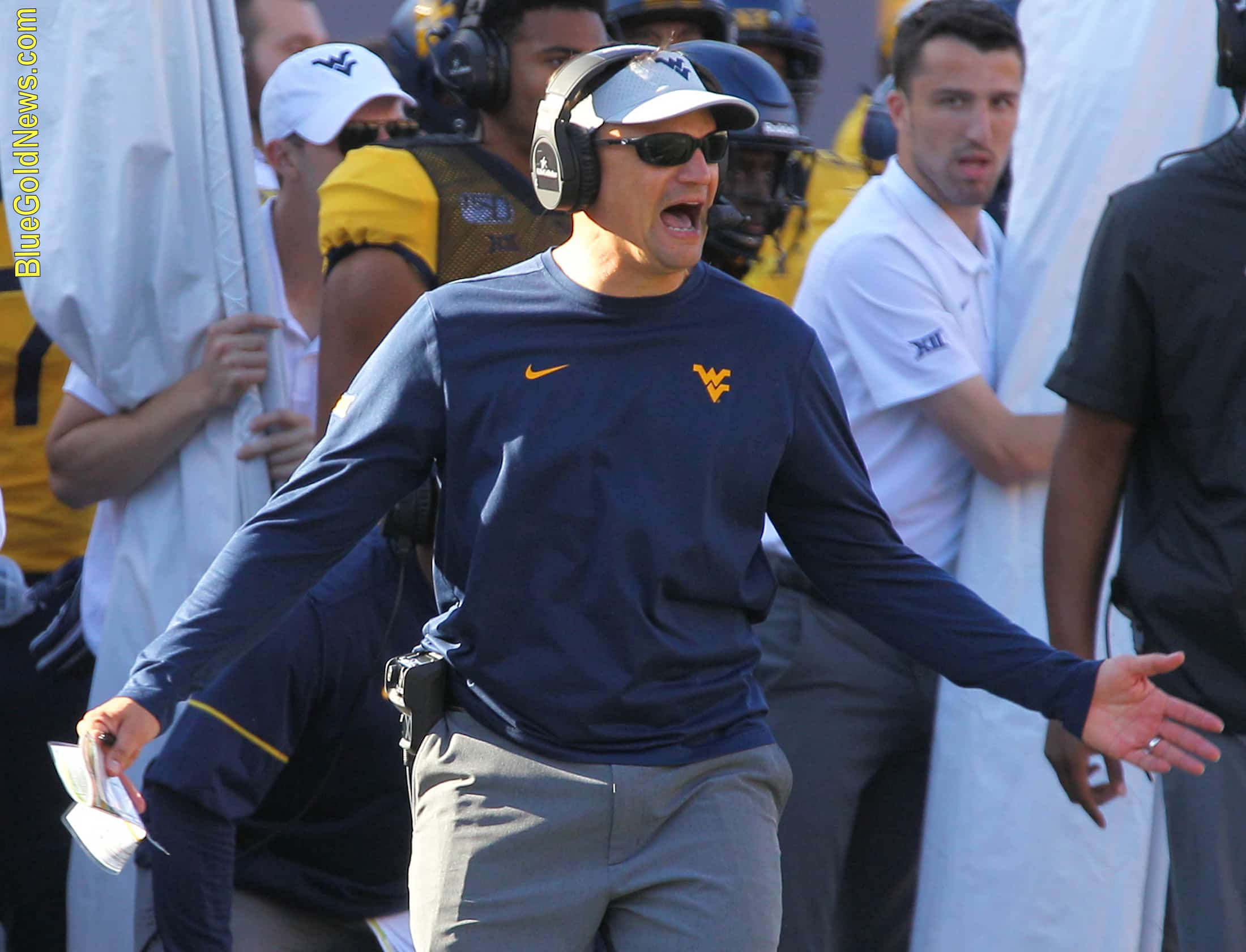 West Virginia head coach Neal Brown expresses displeasure at the pace of the WVU offense