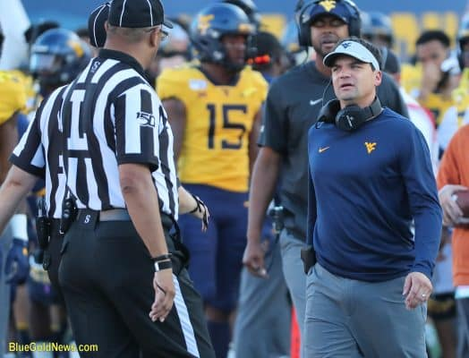 West Virginia head coach Neal Brown questions an official