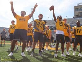 West Virginia players greet Mantrip participants prior to the #WVU - Texas game