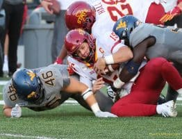 West Virginia defensive linemen Reuben Jones (right) and Reese Donahue (46) bring down Iowa State quarterback Brock Purdy (15)