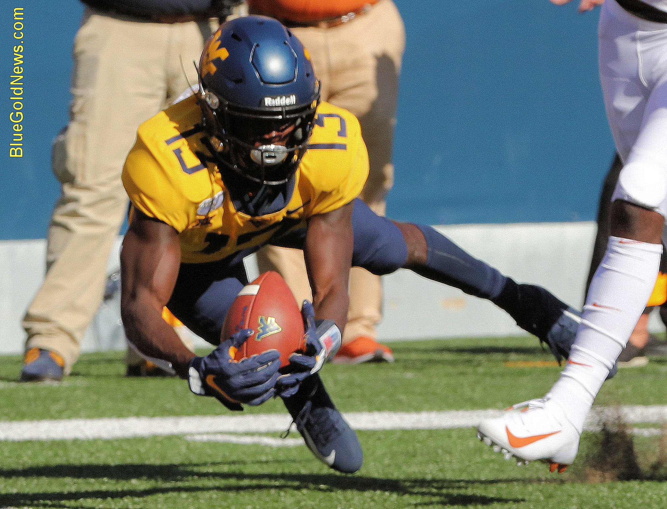 West Virginia wide receiver Sam James dives for the ball on a touchdown reception