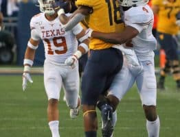 West Virginia receiver Sean Ryan (18) makes a contested catch against Texas' Anthony Cook (4)