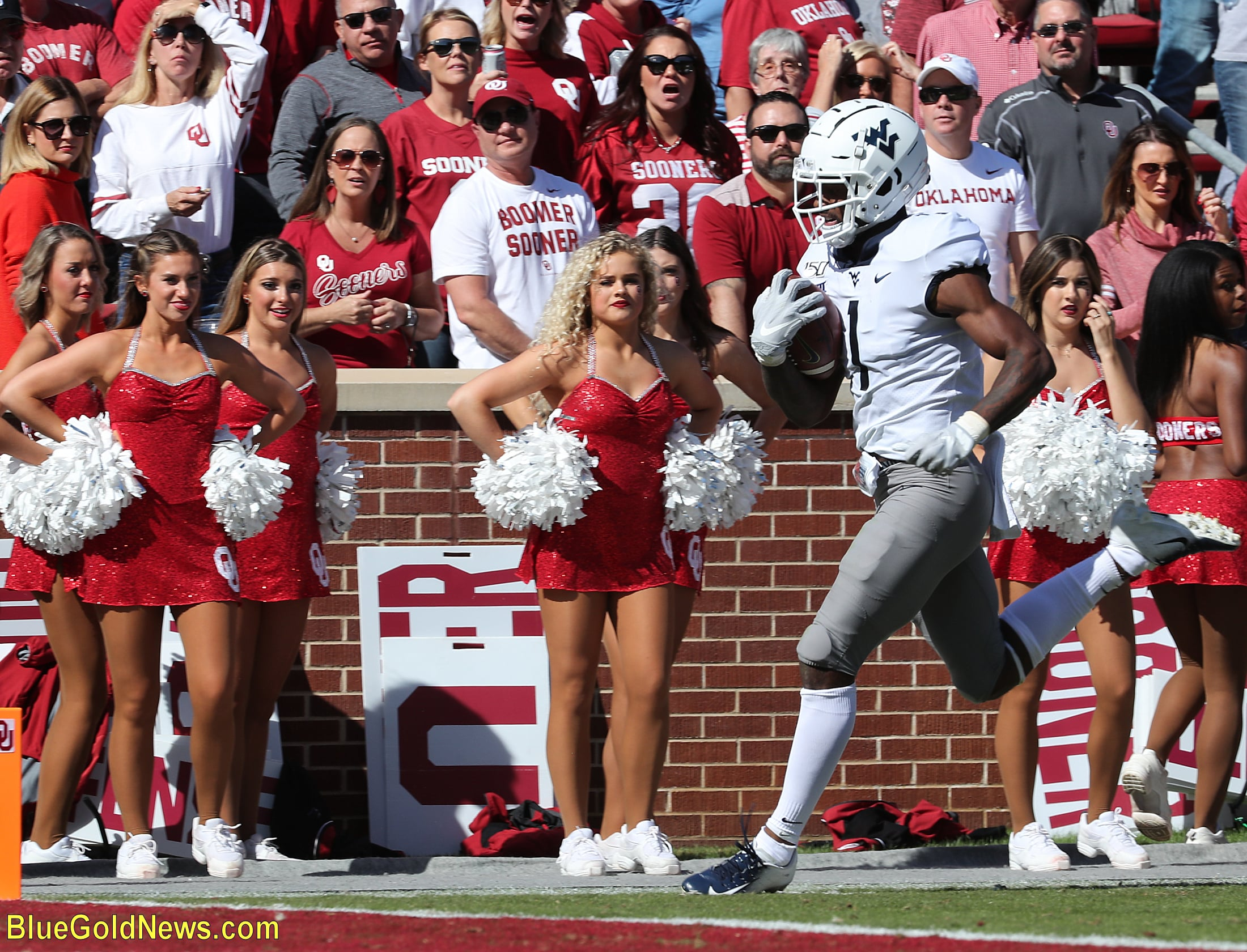 West Virginia receiver TJ Simmons scoots into the end zone in front of dismayed Oklahoma fans