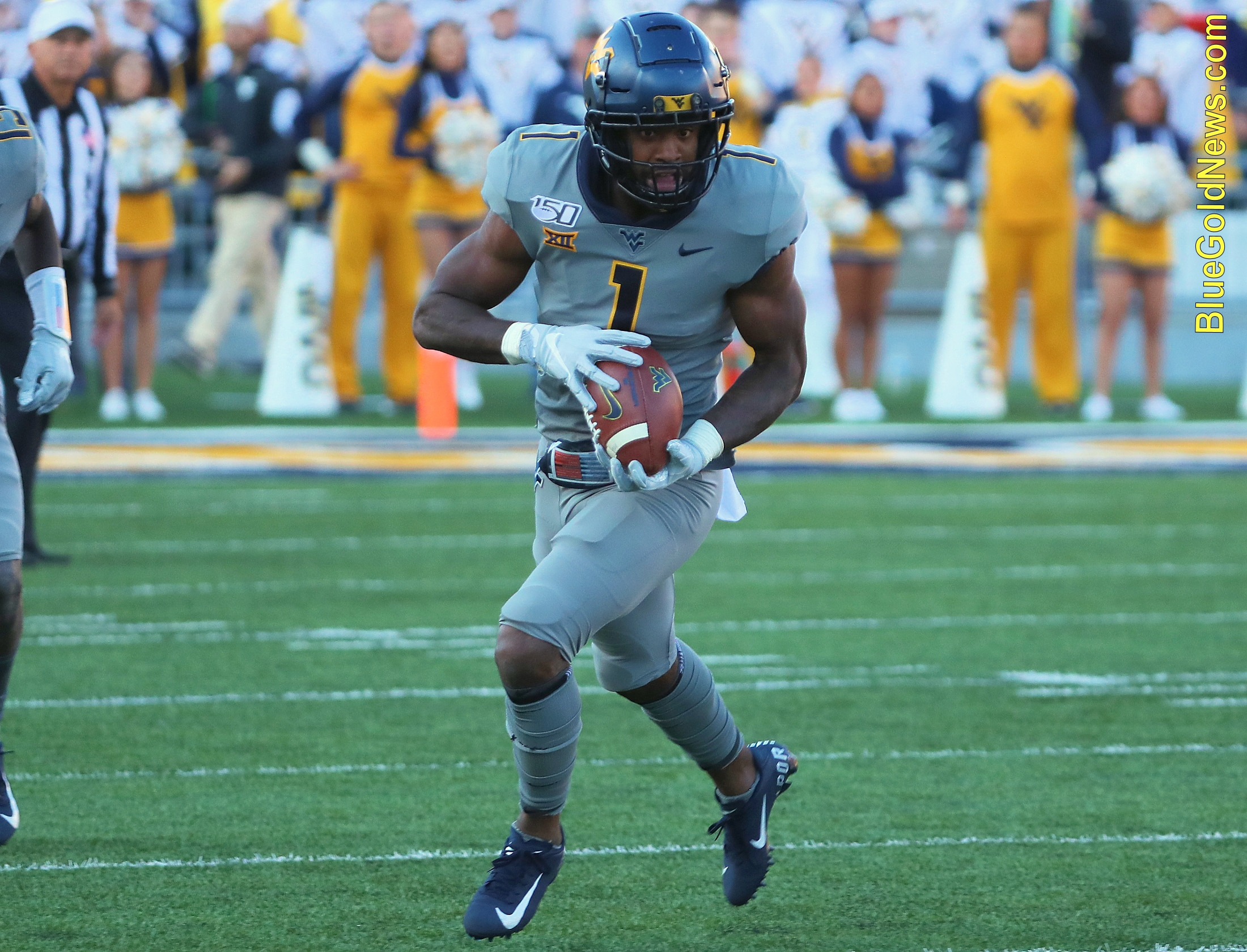 West Virginia receiver TJ Simmons gains yardage after a reception