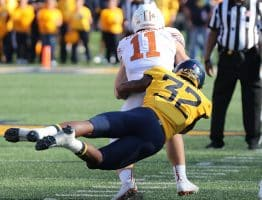 West Virginia bandit VanDarius Cowan tackles Texas quarterback Sam Ehlinger