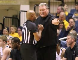 West Virginia head coach Bob Huggins gets up close and personal with official Jeff Anderson