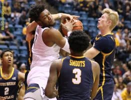 West Virginia forward Derek Culver (1) fights for the ball with Northern Colorado's Brodie Hume (right)