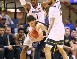 West Virginia defenders Derek Culver (1) and Jermaine Haley (10) spring a late game trap
