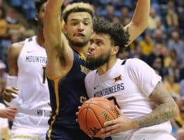 West Virginia guard Jermaine Haley grits out a drive against Northern Colorado